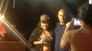 As the party was winding down, Kelly Slater took time to grab a swag bag from his former employer, and pose with an adoring fan.
